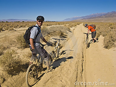 Two men mountain biking.
