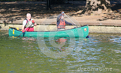 Two men paddling a canoe Editorial Image