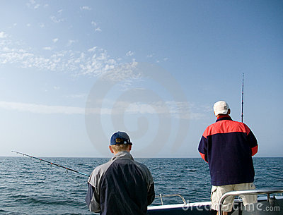 Two men sea fishing.