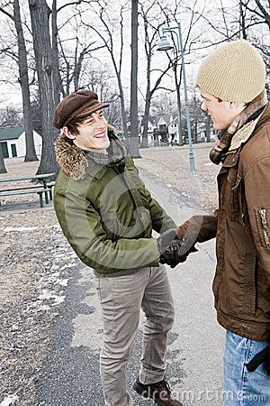 Two men shaking hands in park