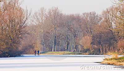Two men skating on nature ice