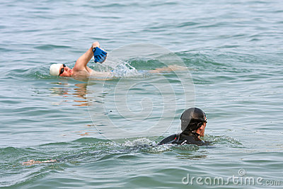 Two Men Swim In Lake Michigan Editorial Stock Photo