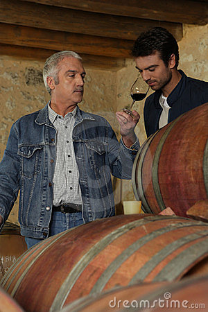 Two men tasting wine