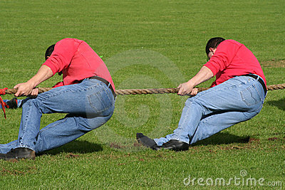 Two men in tug of war