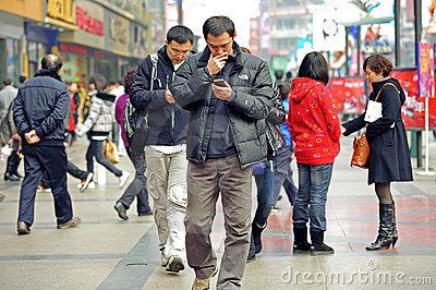 Two men using mobile phone Editorial Photography