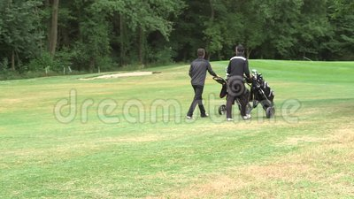 two men walking across the golf course stock video video. Black Bedroom Furniture Sets. Home Design Ideas