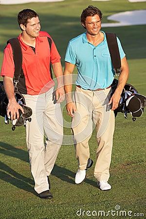 Two Men Walking Along Golf Course