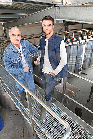 Two men in wine factory