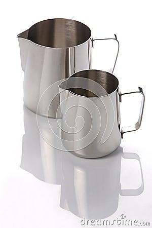 Two metal jugs