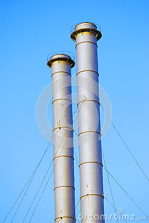 Two metallic tubes, blue sky background. Stock Photo