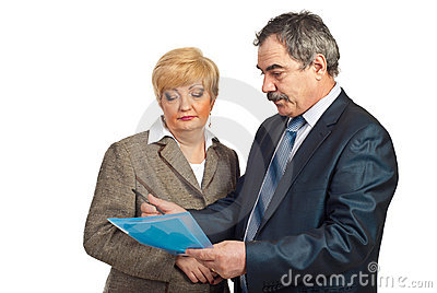 Two middle aged executives reading contract