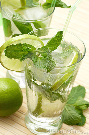 Two mojito cocktails with lime