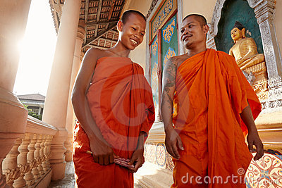 Two monks walk in a buddhist monastery, Asia