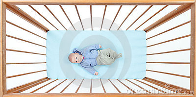 Two months baby boy lying in a crib