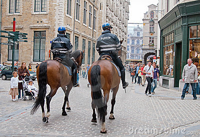 Two mounted policemen patrol the street in center Editorial Photography