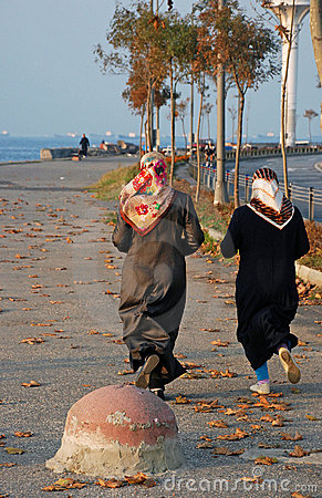 Two Muslim women jogging