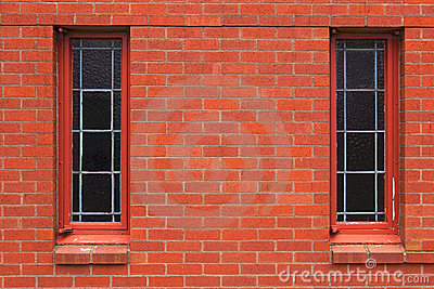 Two narrow windows in brick wall