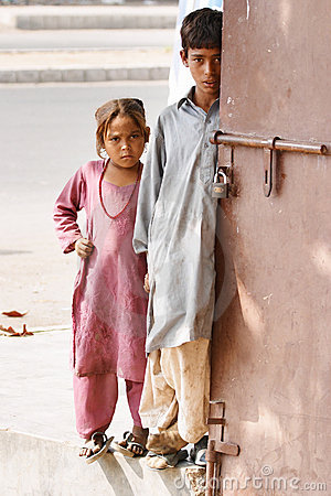 Two needy pakistani children waiting for charity Editorial Image