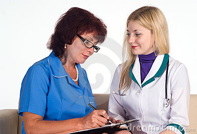 Two nurses sit