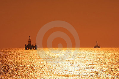 Two offshore oil rigs during s