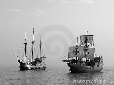 Two Old battle ships at sea