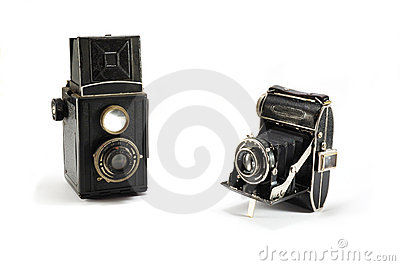 Two old film photo cameras on white background