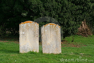 Two old gravestones close together.
