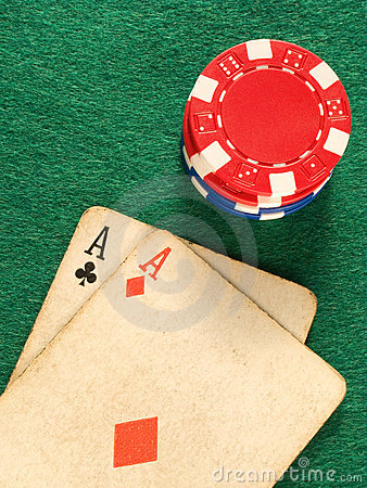Two old poker card aces and poker chips.