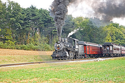 Two old steam trains passing