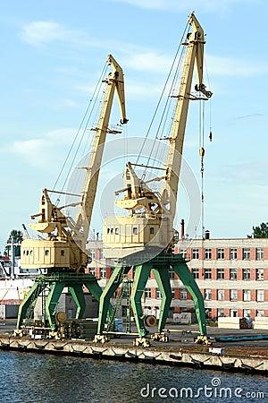 Two old yellow harbor crane