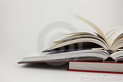 Two open books on a closed book