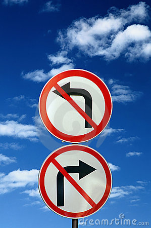 Free Two Opposite Road Signs Against Blue Sky Royalty Free Stock Photo - 6501335