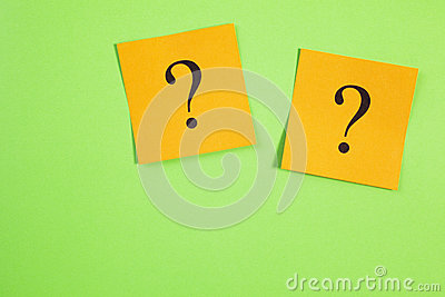 Two Orange Question Marks on Green Background