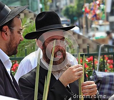 Two Orthodox Jews in black hats picks Lula Editorial Stock Photo