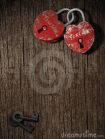 Two padlocks on wood vertical
