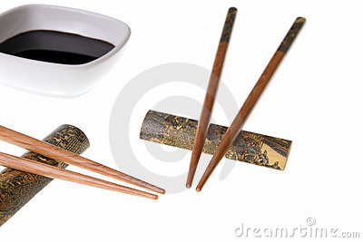 Two pairs of chopsticks and soy sauce