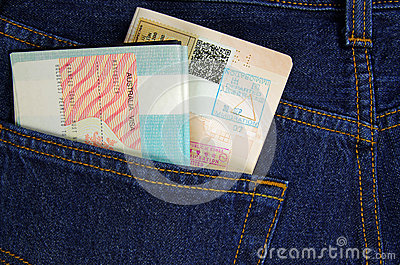 Two passports in a trouser pocket