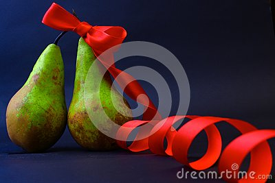 Two pears one in a red gift tape