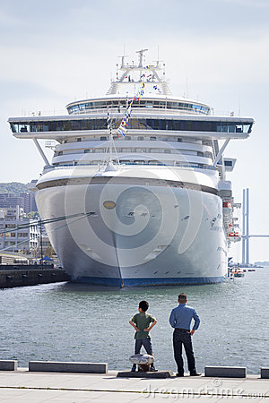 Two People Looking at Cruise Ship, Nagasaki Harbour Editorial Image