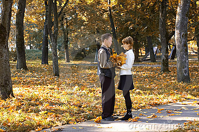 Two people in love in autumn park