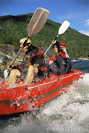 Free Two People Paddling Inflatable Boat Down Rapids Stock Image - 6075691