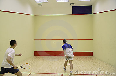 Two people playing squash
