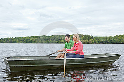 Two people riding in a canoe on a lake