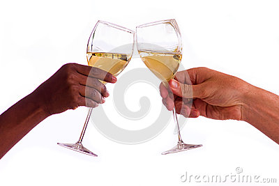 Two people toasting with glasses of white wine