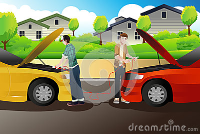 Two people trying to jump start a car