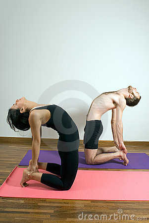two people in a yoga pose  vertical stock images  image