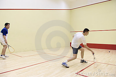 Two person playing squash