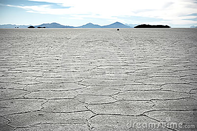 Two persons at the surface of Salt Lake of Uyuni i