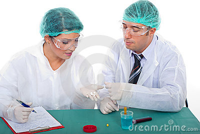 Two pharmacists people examine pills