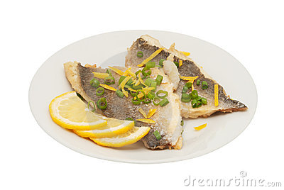 Two pieces of fried fish and lemon segment